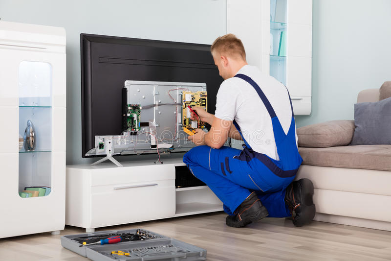 Electrician Checking Television royalty free stock photos