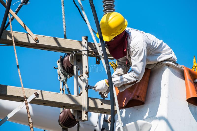 An electrician is checking and tightening. royalty free stock photography