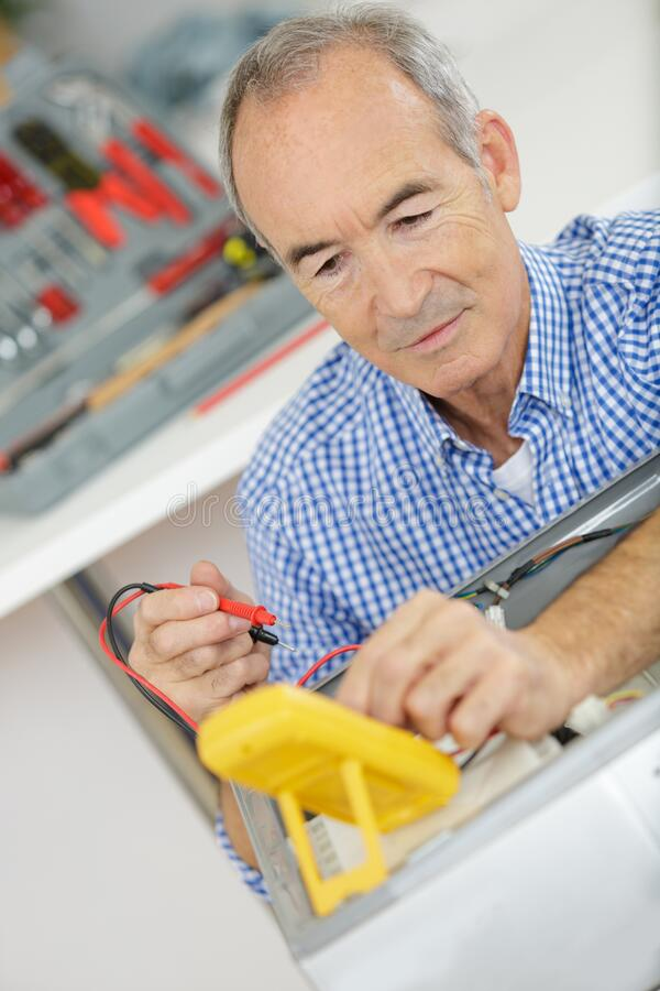 Electrician checking voltage royalty free stock photography
