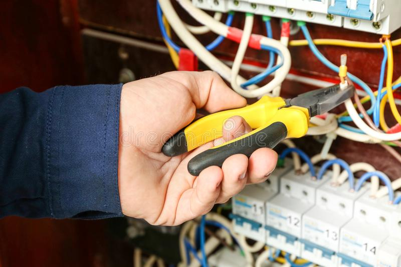 Electrician connecting wires royalty free stock images