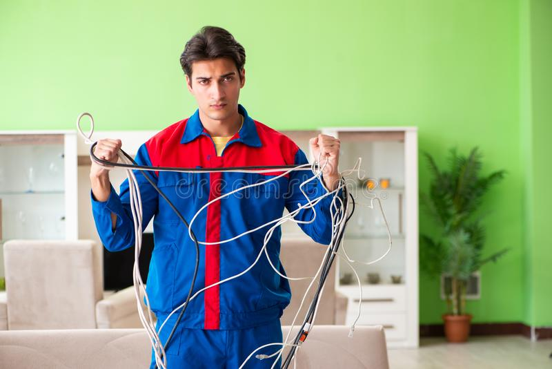 The electrician contractor with tangled cables royalty free stock image