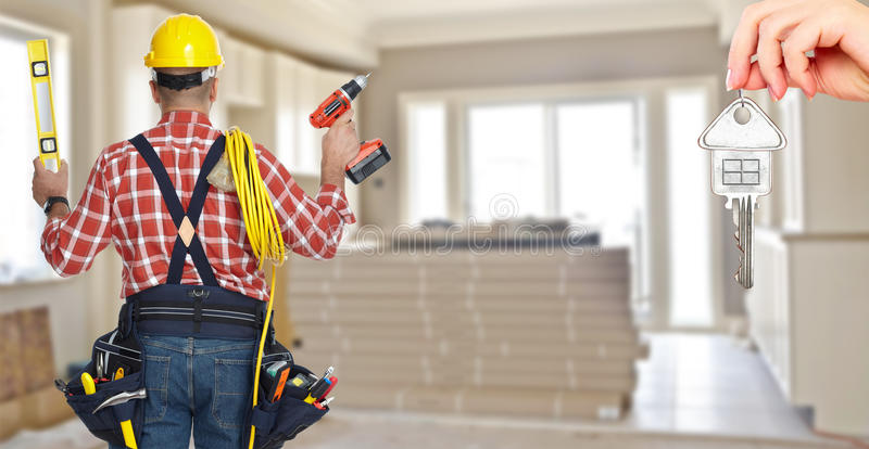 Electrician with drill and cable. royalty free stock images