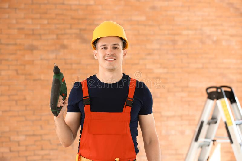 Electrician with drill indoors stock image