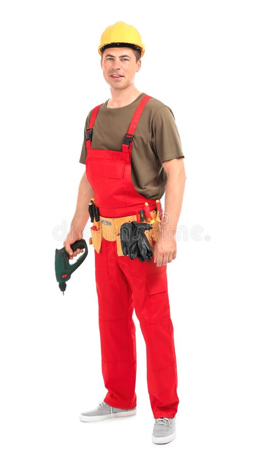 Electrician with drill and tools on white background stock photo