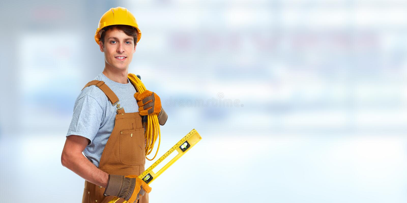Electrician with electrical cable. Professional construction worker electrician with electrical cable stock photography