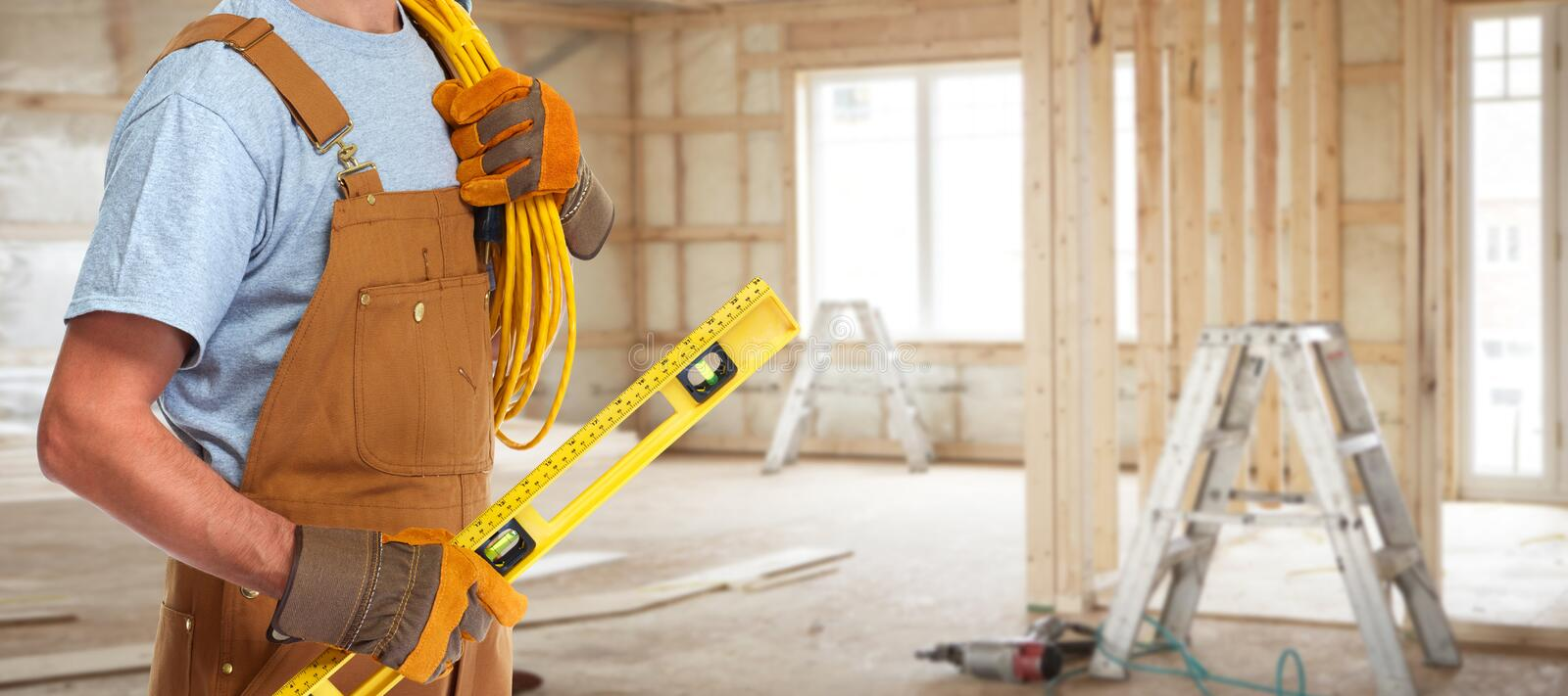 Electrician with electrical cable royalty free stock image