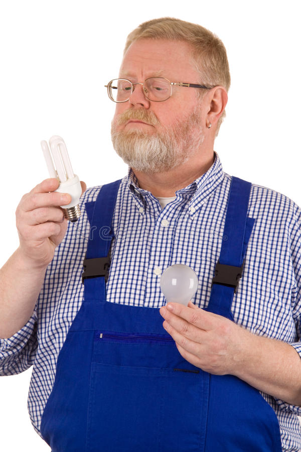 Electrician with energy-saving lamp stock photo