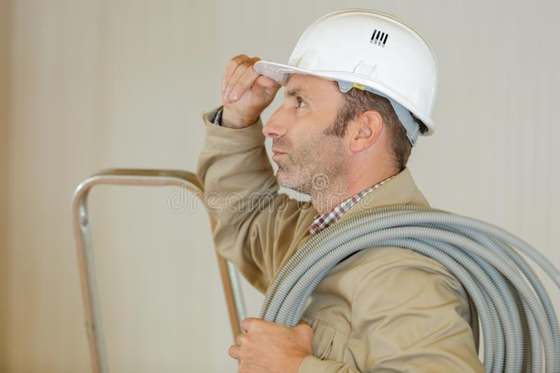 Electrician engineer inspecting electricity power line stock image