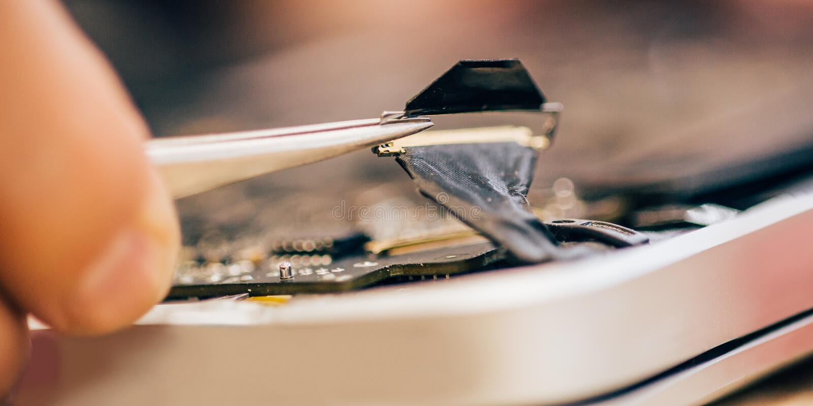 Electrician engineer technician repair faulty laptop computer in electr service royalty free stock photos