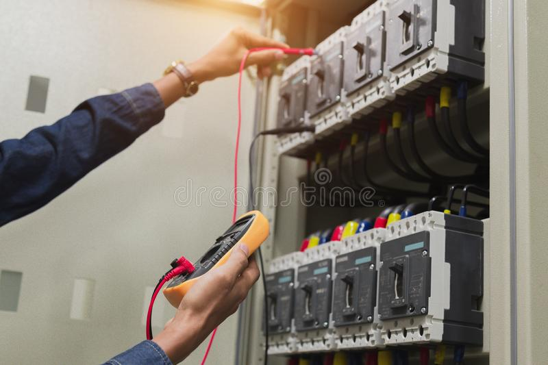 Electrician engineer work  tester measuring  voltage and current of power electric line. royalty free stock photography