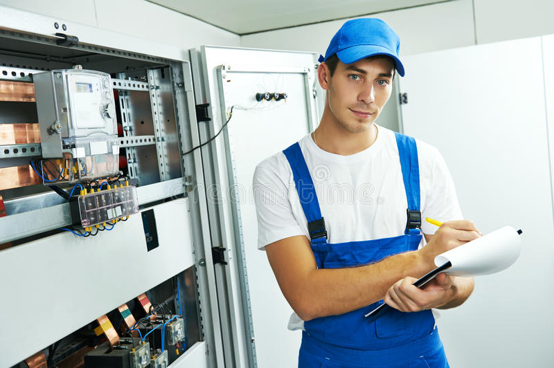 Electrician engineer worker with blueprint project stock photography