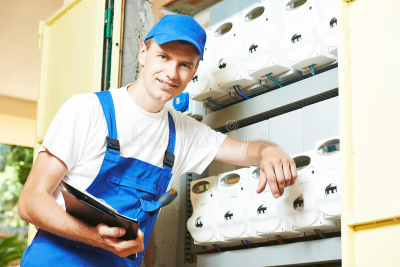 Electrician engineer worker. Inspector in front of fuseboard equipment stock image
