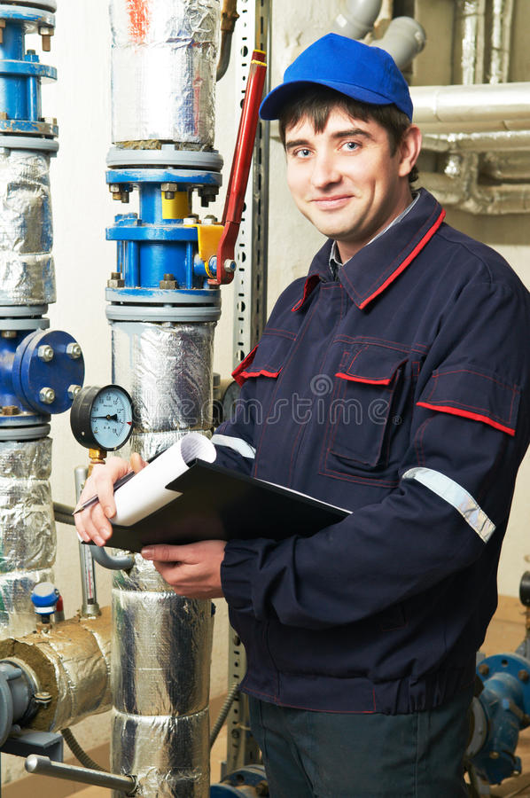 Electrician engineer worker. Inspector in front of fuseboard equipment stock images