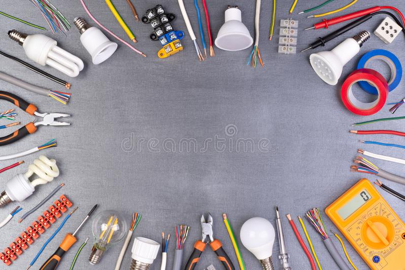 Electrician equipment on metalic background. Electrician equipment and tools on metalic background, top view with copy space stock image
