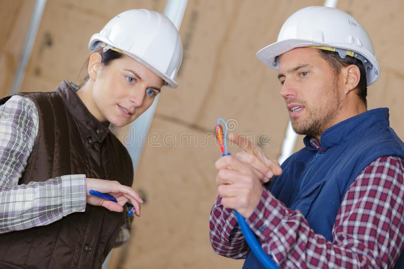 Electrician explaining wire colors royalty free stock photography