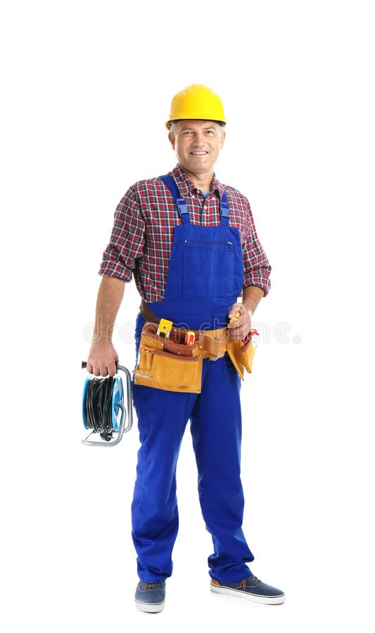 Electrician with extension cord reel and tools wearing uniform. On white background royalty free stock photos