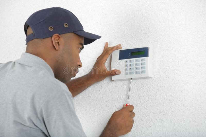 Electrician fitting electronic keypad royalty free stock photos