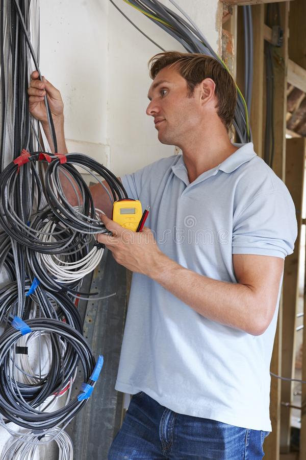 Electrician Fitting Wiring On Construction Site royalty free stock images