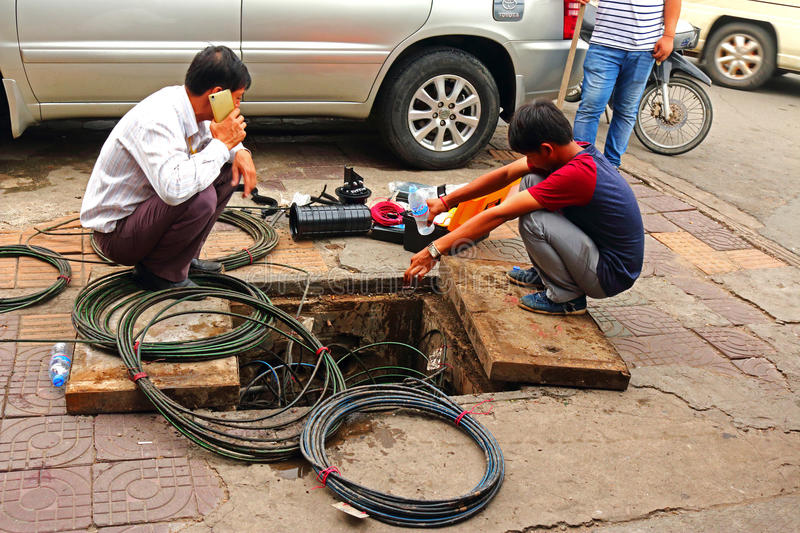 Electrician fixing cables on the street royalty free stock photos