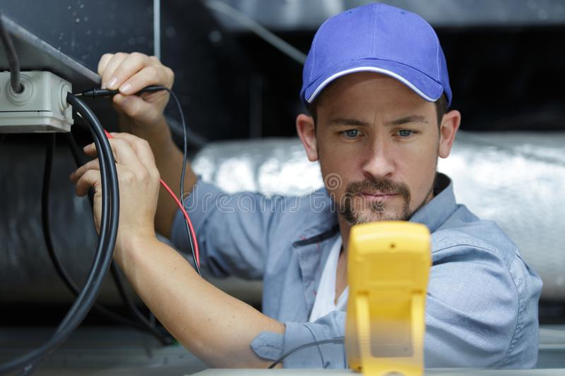 Electrician fixing electric cable royalty free stock photos