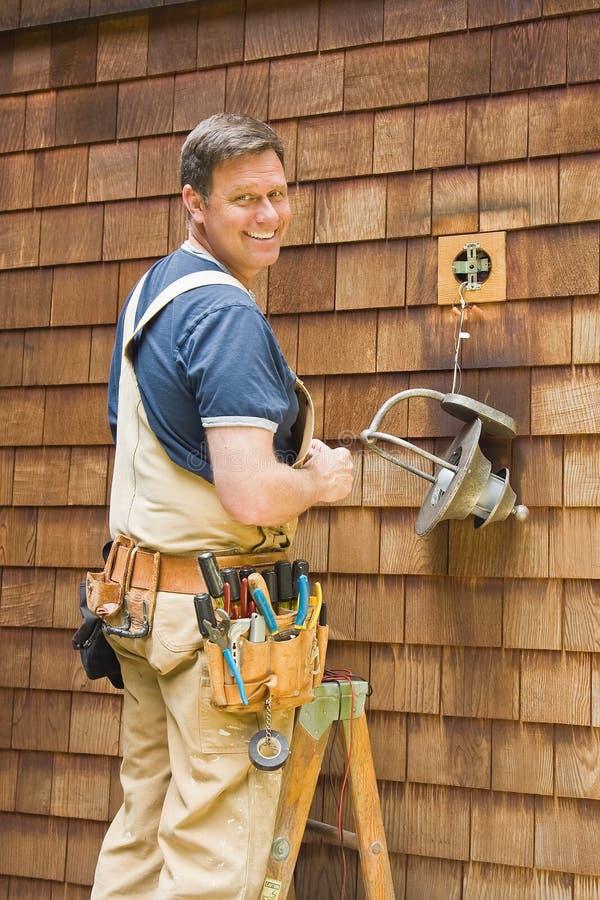 Electrician fixing outdoor light royalty free stock photos