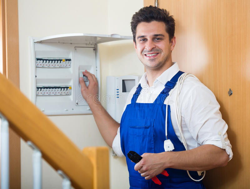 Electrician fixing problems of automatic electric meter stock photos