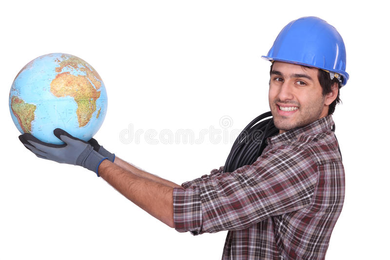Electrician with globe. Electrician holding glove at arms length stock images