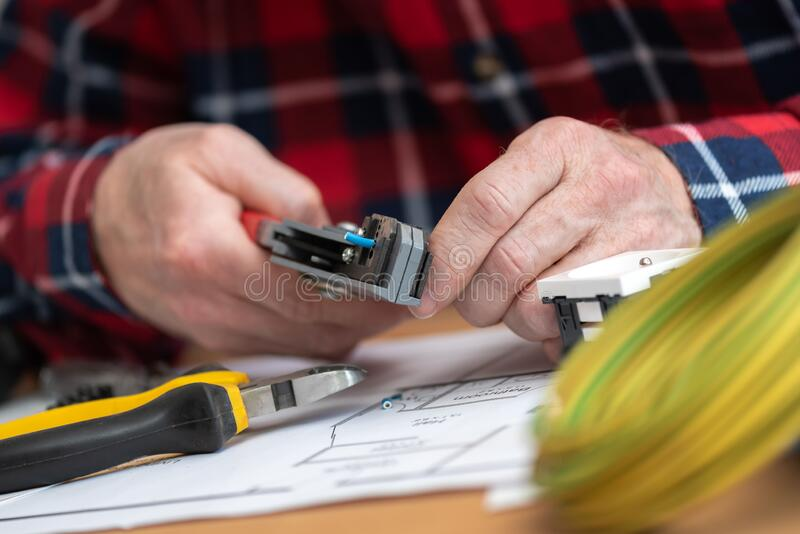 Electrician stripping a wire royalty free stock photo