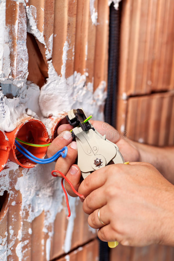 Electrician hands at work royalty free stock photos