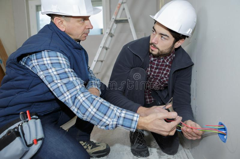 Electrician And His Apprentice Stock Image - Image of ...