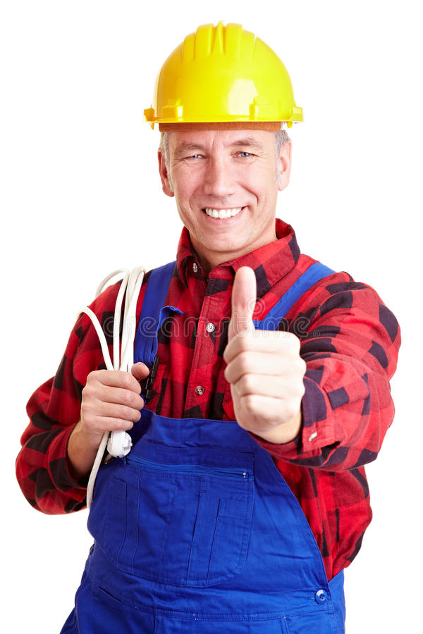 Electrician holding his thumb up royalty free stock images
