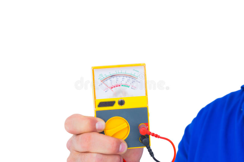 Electrician holding voltage tester. Cropped image of electrician holding voltage tester over white background stock photography