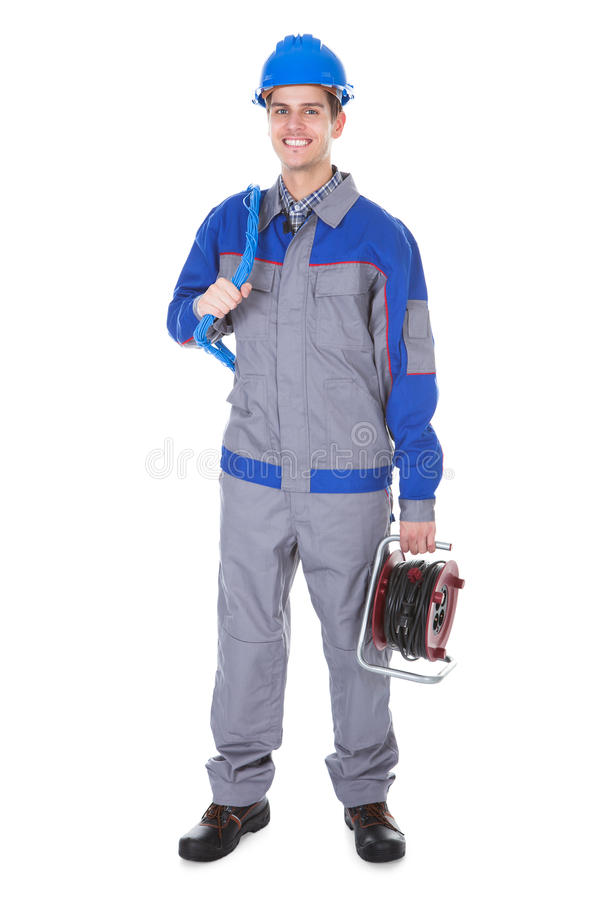 Electrician holding working instrument stock photo