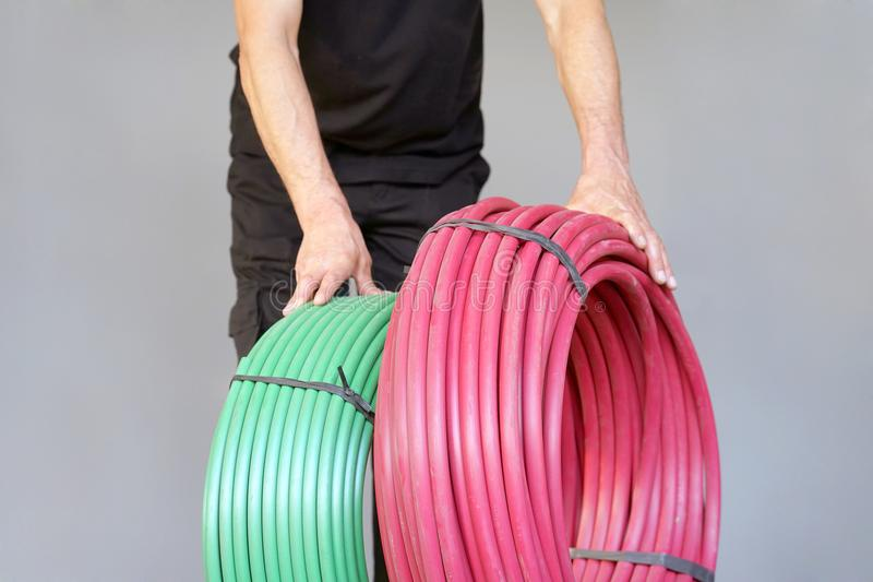 Worker with electrical protective tube royalty free stock photos