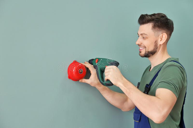 Electrician installing alarm bell stock images