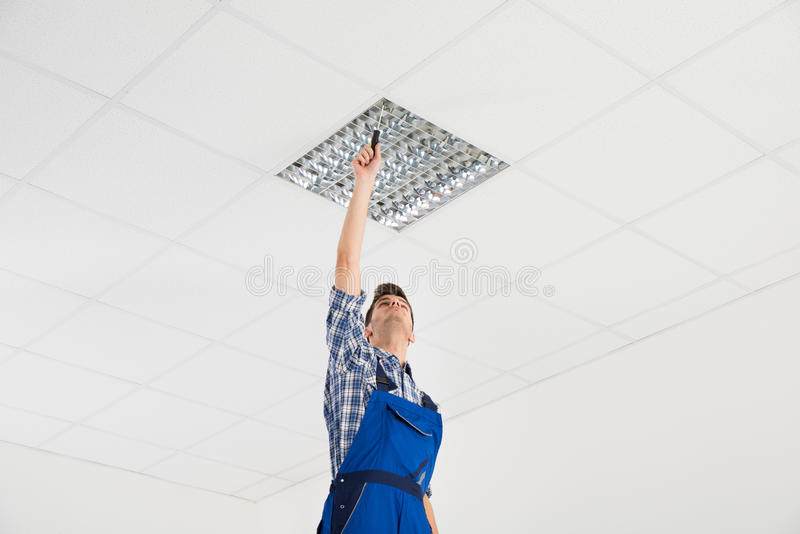 Download Electrician Installing Ceiling Light Stock Image - Image of adult, maintenance: 77509195