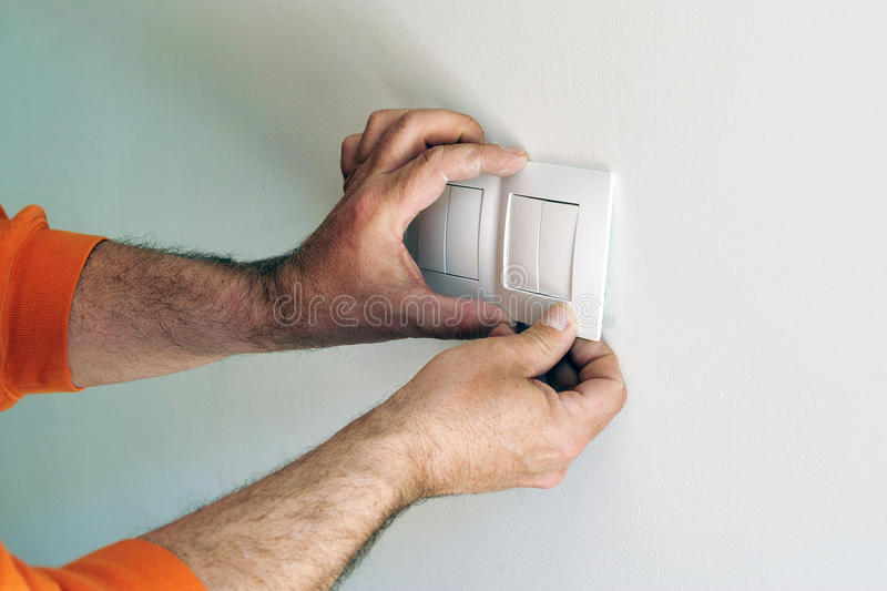 Electrician installing electrical switches in the new house stock photos