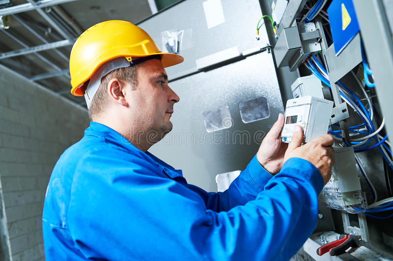 Download Electrician Installing Energy Saving Meter Stock Photo - Image of device, industry: 91496832