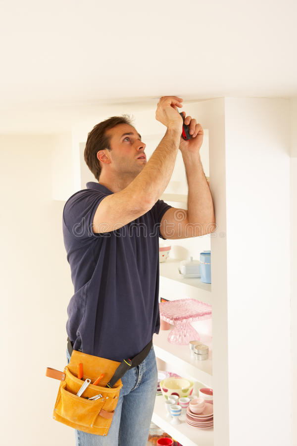 Electrician Installing Light Fitting. In Home royalty free stock image