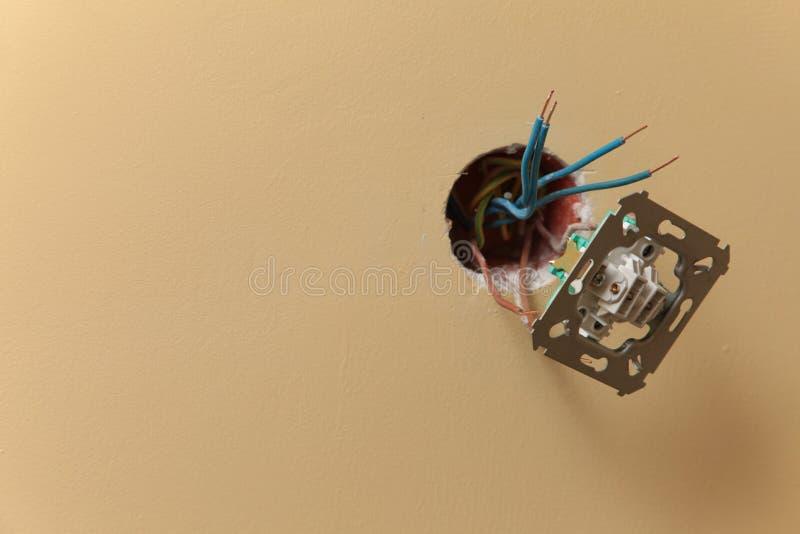 Electrician installing a power socket stock photos