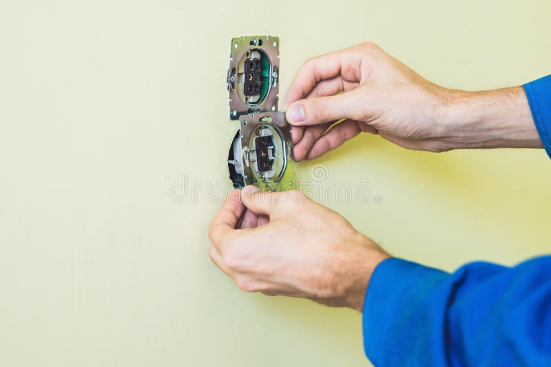 Electrician Installing Socket In New House stock photography