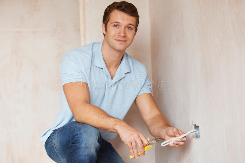 Electrician Installing Socket In New House stock images