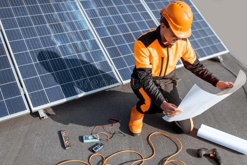 Electrician installing solar panels stock photography