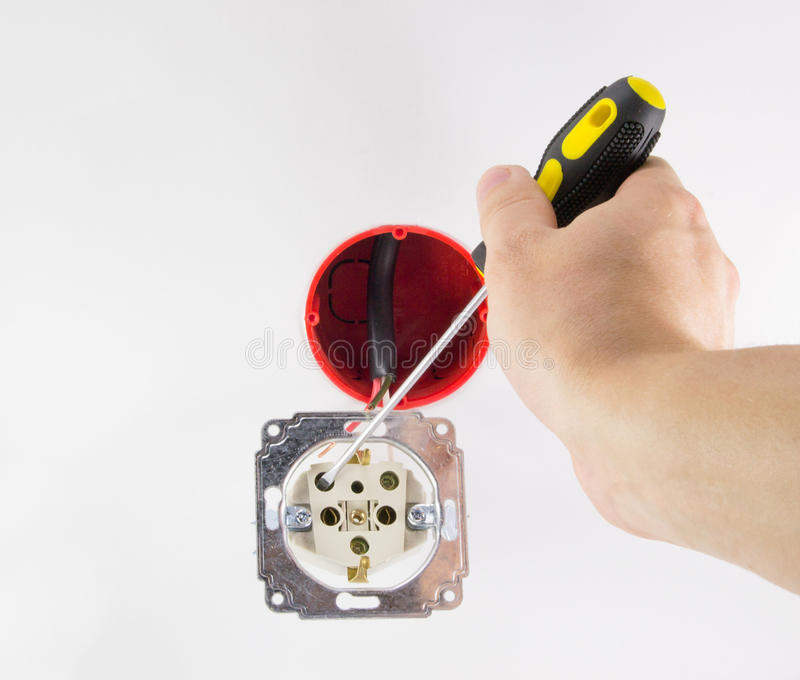 Electrician installs outlet stock photos