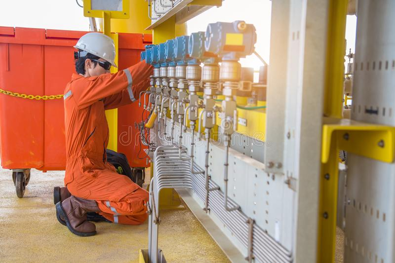Electrician and instrument worker measuring voltage of pressure transmitter. stock images