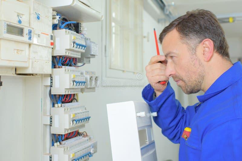 Electrician on a job stock photos