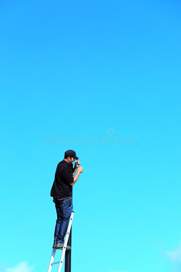 An electrician on the job high up royalty free stock images