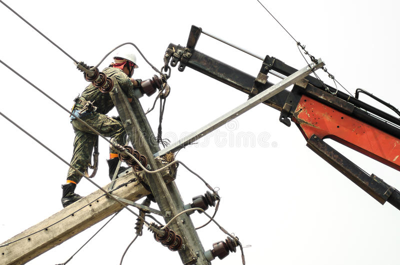 Electrician lineman repairman worker at climbing work royalty free stock images