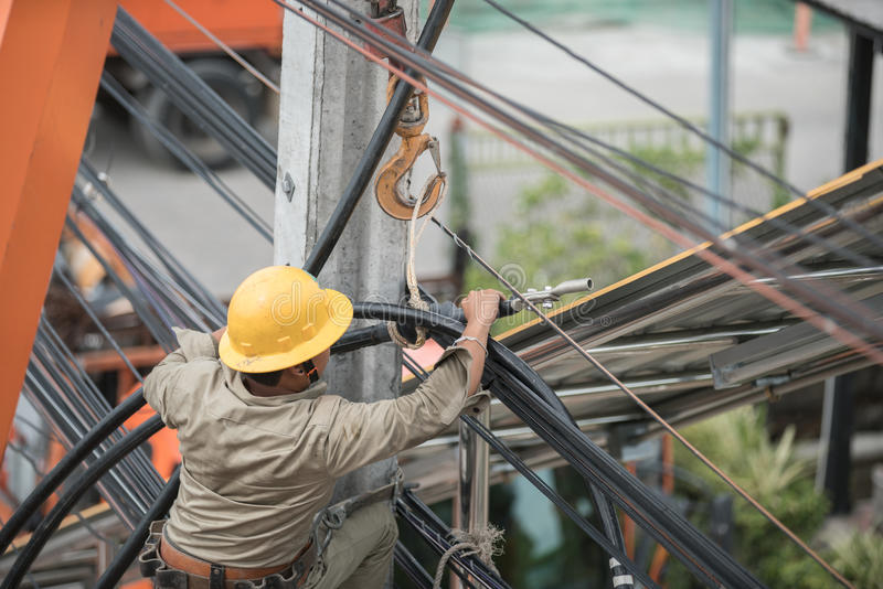 Electrician Man on electric poles. Electrical repairs stock image