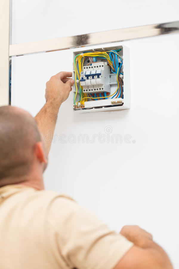Electrician Man Fixing Fuse stock photography